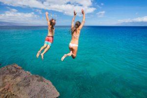 Teenagers jumping into water on Brac island