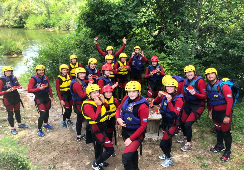 Families canyoning on an active week