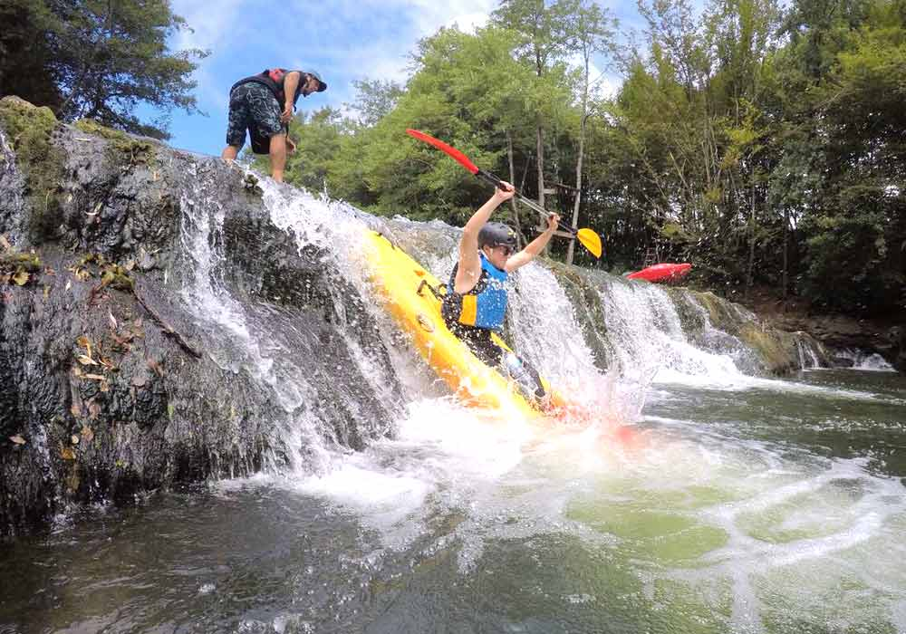 River kayaking on white waters and waterfalls