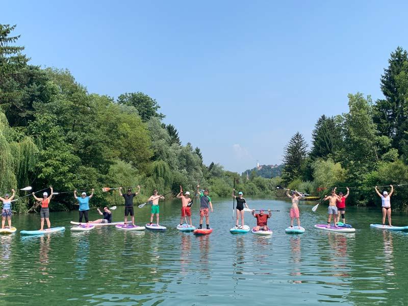 Standup paddle boarding along the river in Ljubljana