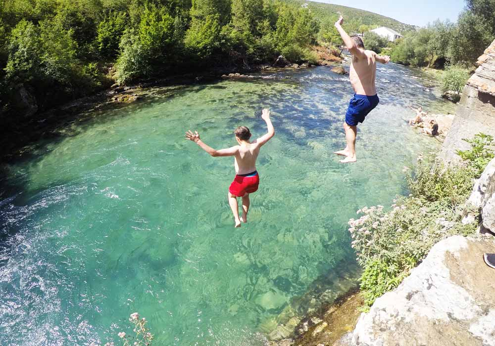 jumping into the river